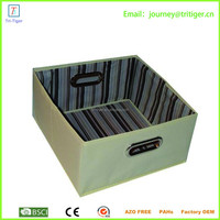 Small decorative cardboard carrying storage box with handle