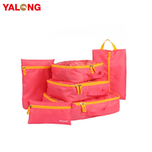Travel organizer with laundry bag clothes storage bags