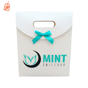 White cardboard custom logo paper bag with bowknot ribbon