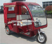 adult electric tricycle with tarpaulin