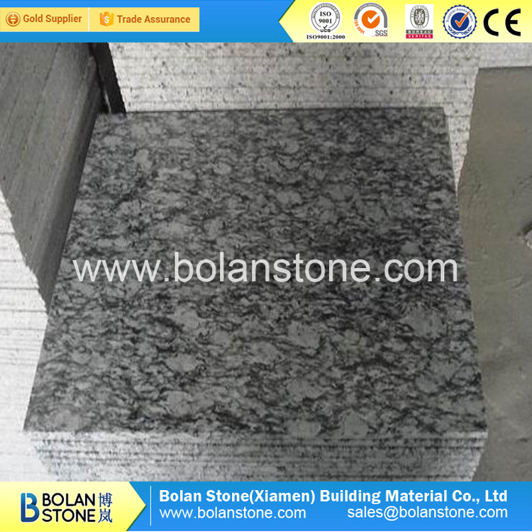 Polished spray white wave white granite from China for sale