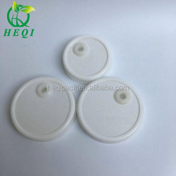 Home using two size plastic fermentation jar lids in wide and regular size with hole