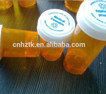 different size small plastic bottles used for medicine