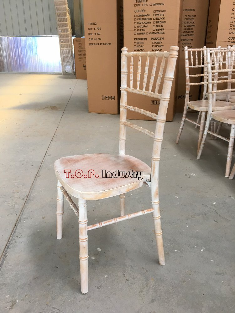 Lime washed wedding chivari chair