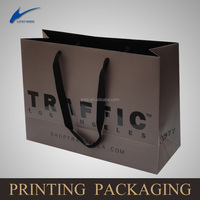 custom logo printed brown craft gift shopping paper bag wholesale/new design shopping paper bag with customized logo printing
