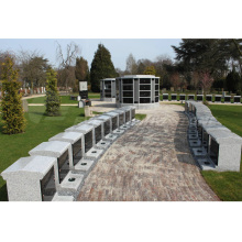 gery octagonal columbarium with black door
