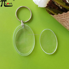 China acrylic keyring factory existing mold blank 49*33mm oval shape acrylic photoframe key chain