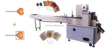 Flat lollipop wrapping machine