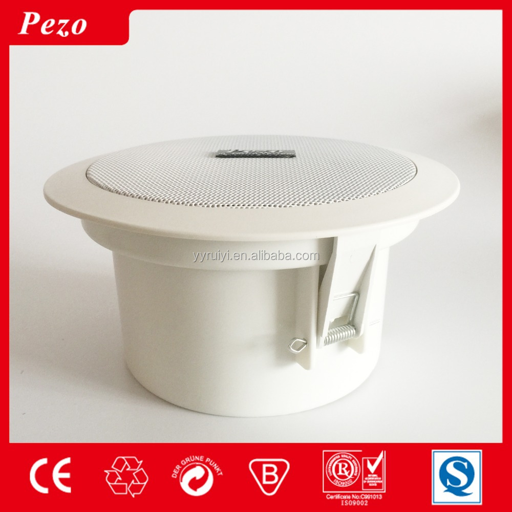 White PA sound system equipment ceiling mounted speakers