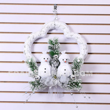two smile snowman sitting on the pine needles holiday time ornament