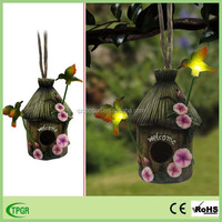 Factory directly hot sale wooden imitation style bird house with solar light