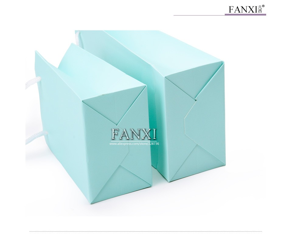 Wholesale custom factory green leatherette paper hand bags for jewellery and gifts packing paper gift bags