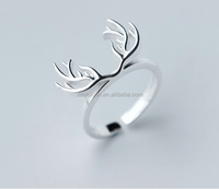 Glossy deer horn designed silver ring