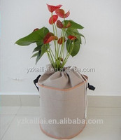 Tan flower wall containers, fabric hanging plant bags, vertical garden hydroponics pots