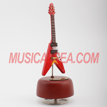 Wooden miniature red guitar and handmade music box