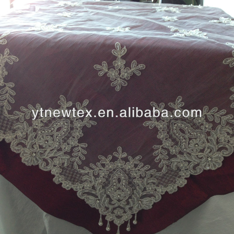polyester with embroidery and hand made beaded tablecloth