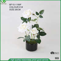 Pure white colour artificial rose flower in ceramic pot