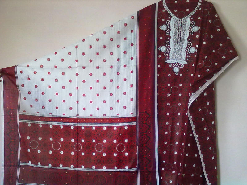 Ajrak print Cotton 3 piece ladies suit with white hand work. Shirt with bordered dupatta and white shalwar