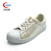 Wholesale cheap new model soft white canvas shoes