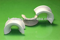 cermaic saddle ring form by incessantly punching