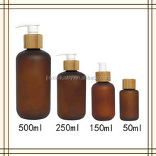 50ml 150ml 250ml 500ml amber frost PET bottle with pump wooden bamboo cap for body wash and shampoo