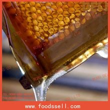 honey in small bottle with beewax honey bee wax pure honey