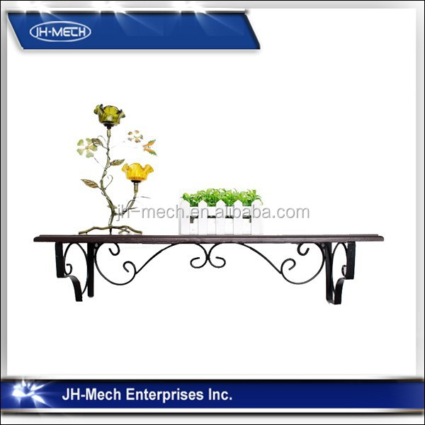 Decorative black wrought iron scrollwork planter stand
