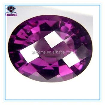oval shaped dark purplish red cz stone