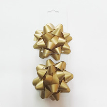 Holiday celebrate it plastic ribbon star bow