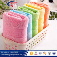 Jacquard and interrupted cotton face towel with 14s/1 yellow orange blue pink green