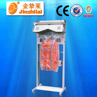 automatic cloth wrapper equipment for clothing packing