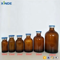 Customizable round amber glass bottles of different sizes