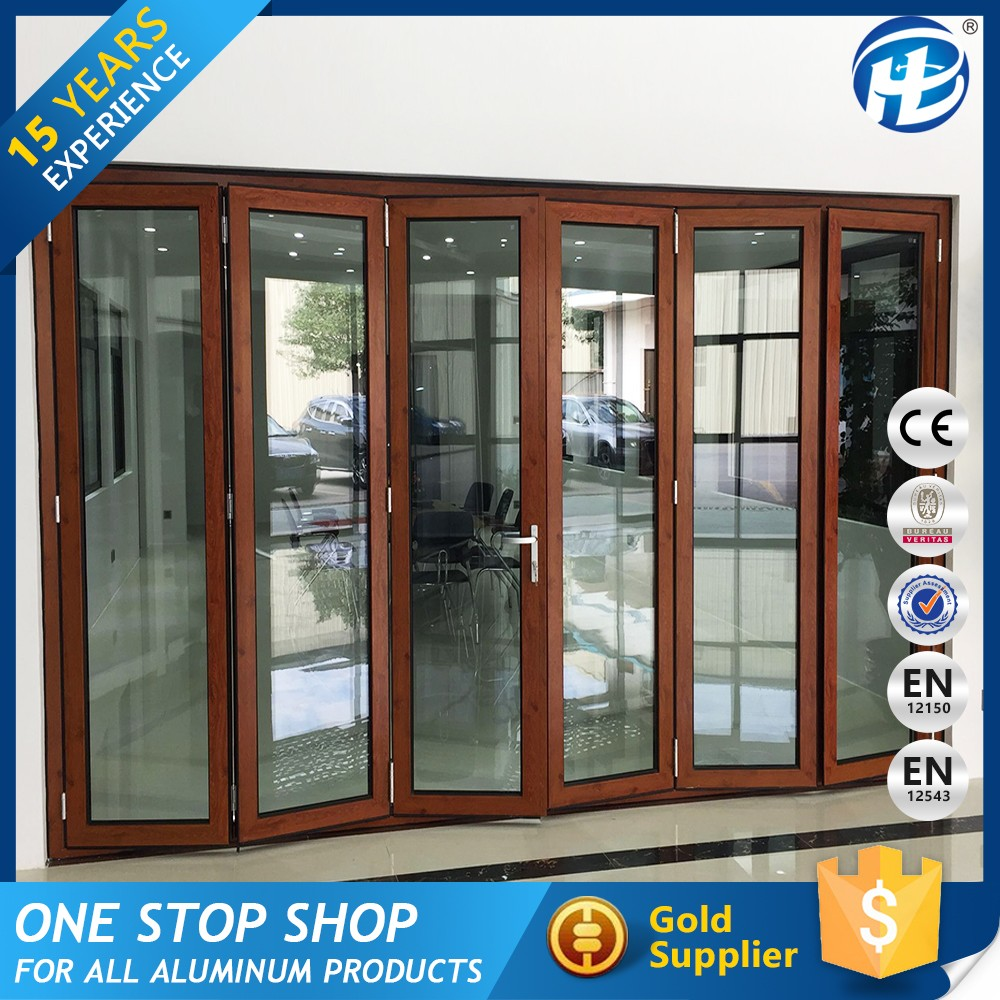 Foldable Door Design exterior accordion doors folding patio doors aluminium with foliages in the vase and white fence outside Buy Direct From China Factory Single Glass Polycarbonate Folding Door Buy Aluminium Folding Doorsaluminium Dooraluminium Doors Product On Alibabacom