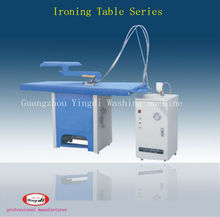 Laundry Shop clothes ironing table and steam iron and steam boiler