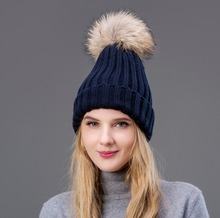 2018 Hot The wool knitted hat winter warm earmuff woman's cap with Fox fur Pompom on the top Also suitable for children