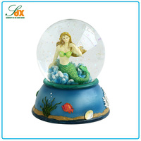 Fashion adorable top sell oem resin mermaid snow globes