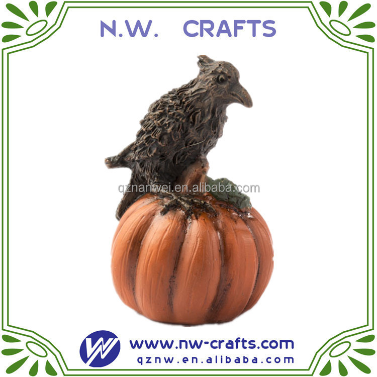 resin miniature crow on pumpkin model