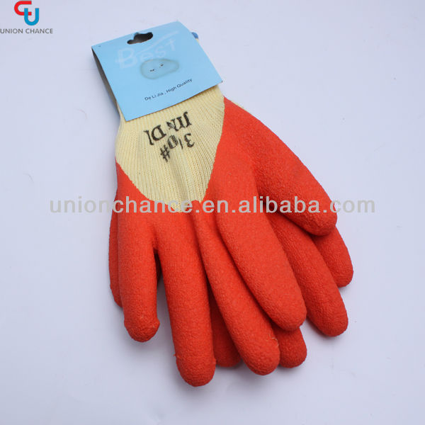 Red protective gloves cutting glass