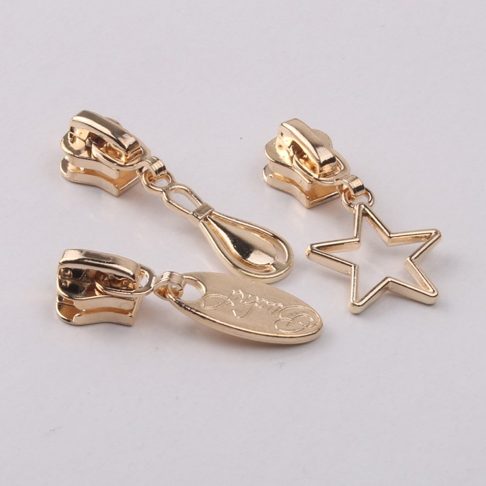 Star shape gold custom made zipper puller for ladies handbags