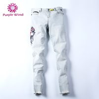 Hot sale young lady's jeans skinny cotton spandex stretch strong bleach with digital printing patch embroidery