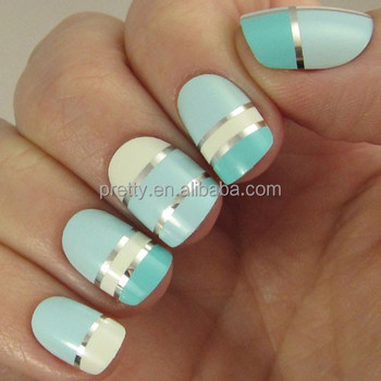 Geometric designed false nails, colorblocked in varying shades of blue and white, seperated by silver lines nail art