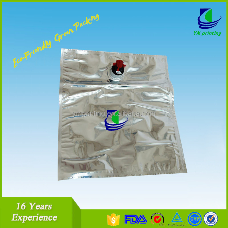 Laminated plastic juice spout bag with cap