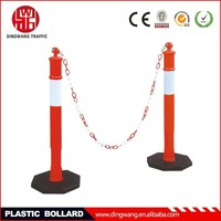 black base and red plastic bollard