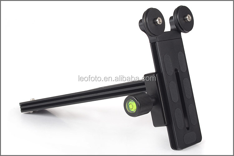 telephoto lens supporting quick release plate
