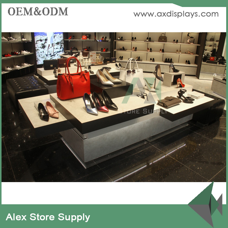retail lady shoe shop glass fixtures and shoes store displays table design