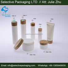 bamboo packaging pumps rubber wooden cap and pumps for ldpe bottles 100ml 120ml 150ml 250ml empty cosmetic containers
