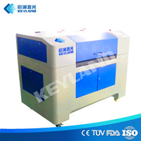 Computerized embroidery laser cutting engraving textile leather fabric cnc co2 bed 1325 held cutter laser machine from china