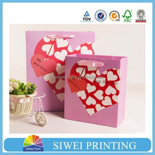 2015 custom made fashional textured paper gift bag lovely factory in guangzhou