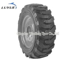 Loaders tyre with reinforced lugs and extra thick center tread