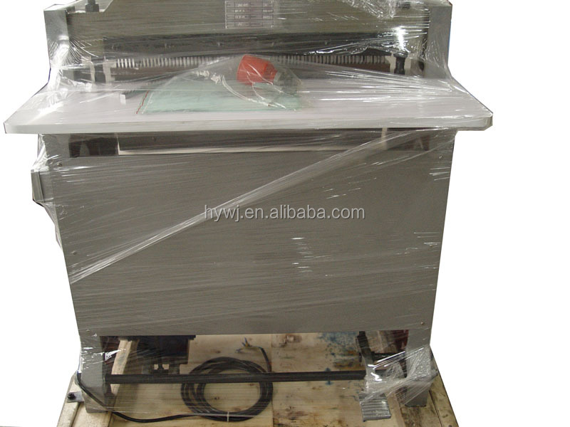 Semi automatic notebook paper punching machine